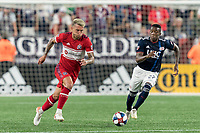 FOXBOROUGH, MA - AUGUST 25: Francisco Calvo #5 of Chicago Fire brings the ball forward as Luis Caicedo closes during a game between Chicago Fire and New England Revolution at Gillette Stadium on August 24, 2019 in Foxborough, Massachusetts.
