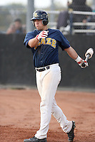 Dustin Houle #9 of the Langley Blaze, a British Columbia Premier League team, plays against a Seattle Mariners minor league team in an exhibition game at Peoria Sports Complex, the Mariners minor league complex, on March 22, 2011 in Peoria, Arizona..Photo by:  Bill Mitchell/Four Seam Images