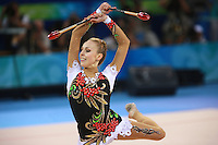 August 23, 2008; Beijing, China; Rhythmic gymnast Inna Zhukova of Belarus expresses with clubs on way to winning silver in the All-Around final at 2008 Beijing Olympics..(©) Copyright 2008 Tom Theobald
