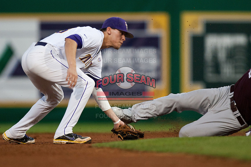 LSU Tigers second baseman JaCoby Jones #23 tags out a Mississippi State base stealer during the NCAA baseball game on March 16, 2012 at Alex Box Stadium in Baton Rouge, Louisiana. LSU defeated Mississippi State 3-2 in 10 innings. (Andrew Woolley / Four Seam Images)