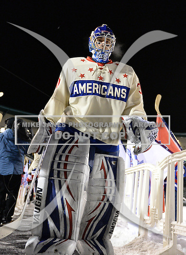 Rochester Amerks goalie Matt Hackett (30) walks to the rink before the first period of The Frozen Frontier outdoor AHL game against the Lake Erie Monsters at Frontier Field on December 13, 2013 in Rochester, New York.  (Copyright Mike Janes Photography)