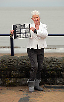 Pictured: Pat Stewart at Barry, south Wales, holding a contact sheet from the photo-shoot in Blackpool by Bert Hardy dated 1951.<br />
