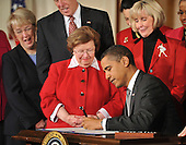 """Washington, DC - January 29, 2009 -- United States President Barack Obama signs the Lilly Ledbetter Fair Pay Restoration Act in the East Room of the White House in Washington, DC on Thursday, January 29, 2009.  The act """"makes it easier for women and others to sue for pay discrimination, even if the discrimination has prevailed for decades"""".  From left to right: United States Senator Patty Murray (Democrat of Washington); United States House Majority Leader Steny Hoyer (Democrat of Maryland); United States Senator Barbara Mikulski (Democrat of Maryland); President Obama; and Lilly Ledbetter..Credit: Ron Sachs - CNP"""