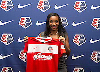 #1 overall pick Crystal Dunn of the Washington Spirit stands her new jersey during the NWSL draft at the Pennsylvania Convention Center in Philadelphia, PA, on January 17, 2014.