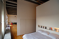 The bedroom is screened from the main living area by floating walls