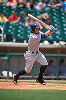Pensacola Blue Wahoos designated hitter Nick Longhi (24) follows through on a swing during a game against the Birmingham Barons on May 9, 2018 at Regions Field in Birmingham, Alabama.  Birmingham defeated Pensacola 16-3.  (Mike Janes/Four Seam Images)