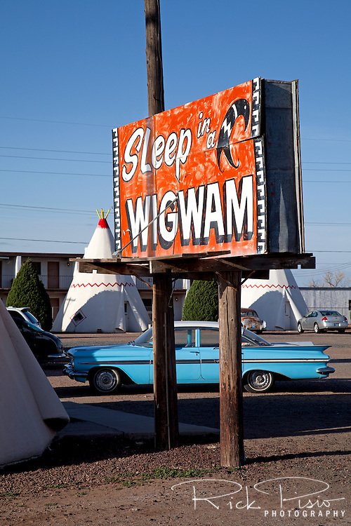 Located on Route 66 in Holbrook, Arizona, Wigwam Village #6 was built by Chester E. Lewis in 1950 and based on the original plans patented by Frank A. Redford in 1936. The motel consist of fifteen concrete and steel teepees, each with a base diameter of 14 feet, clustered around a main office building. Lewis operated the motel until 1974 when the Interstate bypassed downtown Holbrook. Chester died in 1986 and two years later his sons Clifton, Paul, and daughter Elinor renovated the motel and reopened it in 1988.<br />