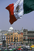 Mexico City. Mexican flag flying over the Zocalo (Plaza de la Constitucion).