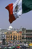 Mexico City. Mexican flag flying over the Zocalo (Plaza de la Constitucion).