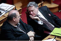 Pictured: Work Minister Giorgos Katrougalos (R) Sunday 08 May 2016<br /> Re: Greek Parliament votes on pension and welfare reforms, Athens, Greece