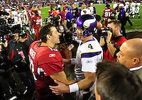 Dec 6, 2009; Glendale, AZ, USA; Arizona Cardinals quarterback Kurt Warner (left) greets Minnesota Vikings quarterback Brett Favre following the game at University of Phoenix Stadium. The Cardinals defeated the Vikings 30-17. Mandatory Credit: Mark J. Rebilas-