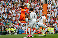 Malaga´s goalkeeper Kameni and Real Madrid´s Cristiano Ronaldo and Karim Benzema