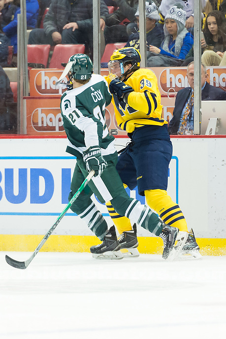 "The University of Michigan ice hockey team loses, 3-2, in overtime to  to MSU in the ""Dual in the D"" at Joe Louis Arena in Detroit on Feb. 5, 2016."