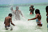 MAURITIUS, a family plays and enjoys a hot day at the beach, Ile aux Cerfs Island, the Indian Ocean