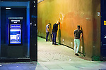 © Joel Goodman - 07973 332324 . 11/09/2016 . Manchester , UK . Three men urinate in an alleyway off of Market Street . Revellers out in Manchester City Centre . Photo credit : Joel Goodman