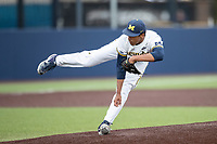 Michigan Wolverines pitcher Isaiah Paige (25) follows through with his delivery in the NCAA baseball game against the Michigan State Spartans on May 7, 2019 at Ray Fisher Stadium in Ann Arbor, Michigan. Michigan defeated Michigan State 7-0. (Andrew Woolley/Four Seam Images)