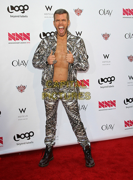 Perez Hilton.LOGO's 2012 'NewNowNext' Awards held at Avalon, Hollywood, California, USA..5th April 2012.full length white silver jacket trousers topless chest mouth open stubble facial hair funny.CAP/ADM/FS.©Faye Sadou/AdMedia/Capital Pictures.