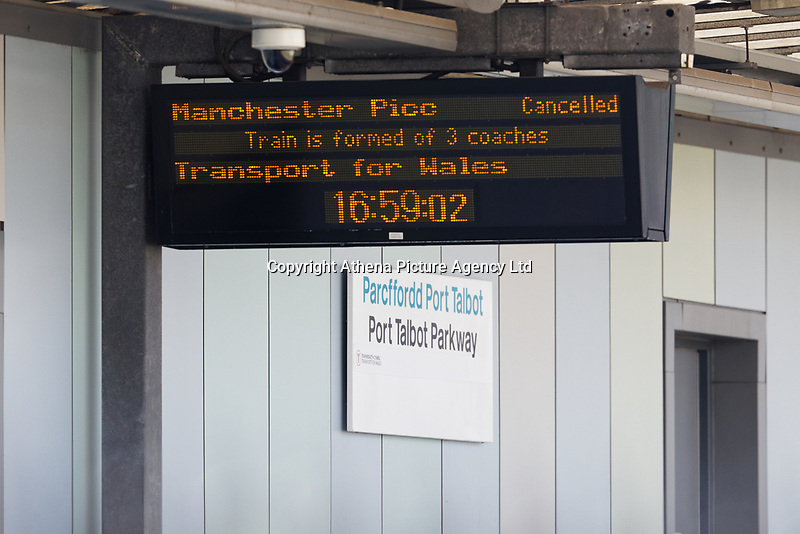 Pictured: A screen with a list of cancelled services on one of the platforms of the Port Talbot Parkway railway station in south Wales, UK. Wednesday 03 July 2019<br /> Re: Two rail workers have died after being hit by a passenger train between Port Talbot Parkway and Bridgend stations in south Wales, UK.<br /> The pair were struck near Margam by the Swansea to London Paddington train at about 10am.<br /> They were pronounced dead at the scene and a third person was treated for shock, but was not injured.