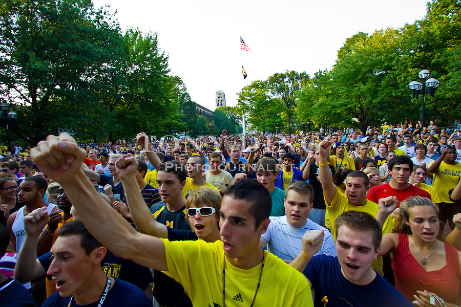 Engineering freshman Mike Sully, front center, of Troy, Mich. sing the Michigan fight song during a football pep rally on the University's Diag, Friday, Sept. 2, 2011 in Ann Arbor, Mich. (Tony Ding for The New York Times)