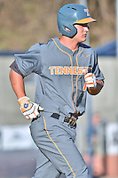 Tennessee Volunteers third baseman Nick Senzel (13) runs to first during a game against the UNC Asheville Bulldogs at McCormick Field on March 15, 2016 in Asheville, North Carolina. The Volunteers defeated the Bull Dogs 7-3. (Tony Farlow/Four Seam Images)