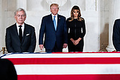 US President Donald J. Trump (C) and First Lady Melania Trump (R) pay their respects in front of the flag-draped casket of late US Supreme Court Justice John Paul Stevens as he lies in repose in the Great Hall of the Supreme Court, in Washington, DC, USA, 22 July 2019. Stevens, who served on the Supreme Court for nearly thirty-five years, died at age ninety-nine, 16 July.<br /> Credit: Michael Reynolds / Pool via CNP
