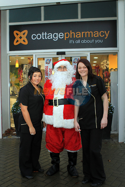 Christmas Customer Day in the Cottage Pharmacy 2011...(Photo credit should read Jenny Matthews www.newsfile.ie)....This Picture has been sent you under the conditions enclosed by:.Newsfile Ltd..The Studio,.Millmount Abbey,.Drogheda,.Co Meath..Ireland..Tel: +353(0)41-9871240.Fax: +353(0)41-9871260.GSM: +353(0)86-2500958.email: pictures@newsfile.ie.www.newsfile.ie.