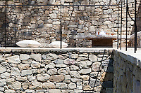 Terraces of beautifully shaped natural stone add colour and texture to the courtyard garden