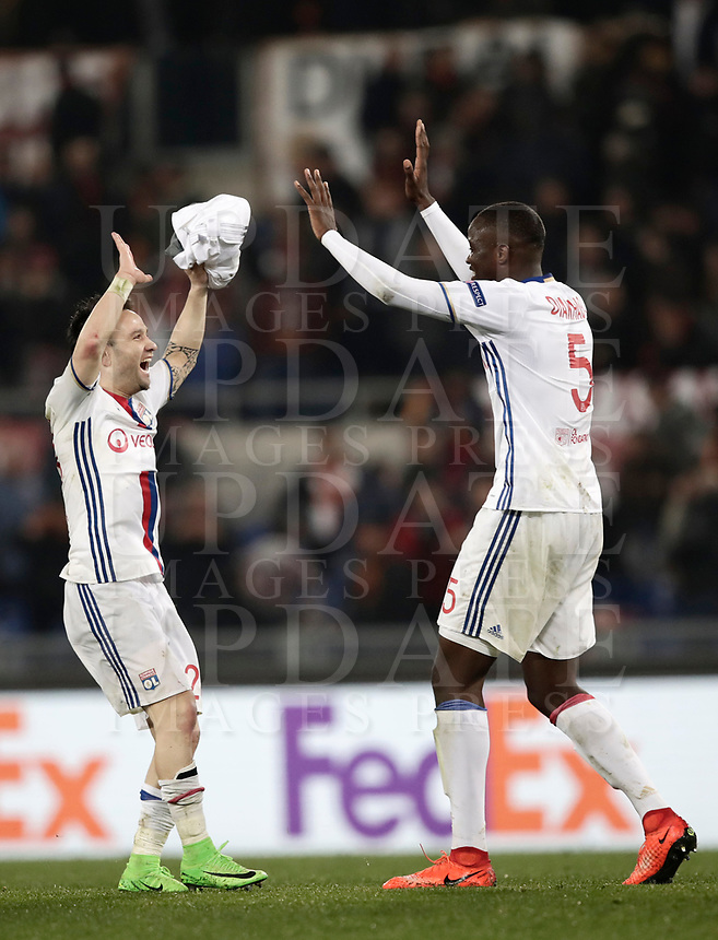 Football Soccer: Europa League Round of 16 second leg, Roma-Lyon, stadio Olimpico, Roma, Italy, March 16,  2017. <br /> Lyon's Mathieu Valbuena (l) and Mounter Diakhaby (r) celebrate at the end of the Europe League football soccer match between Roma and Lyon at the Olympique stadium, March 16,  2017. <br /> Despite losing 2-1, Lyon reach the quarter finals for 5-4 aggregate win.<br /> UPDATE IMAGES PRESS/Isabella Bonotto