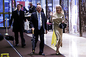 Donald Trump Campaign Manager Kellyanne Conway and Former United States Vice President Dan Quayle walk through the lobby of Trump Tower on November 29, 2016 in New York City.    <br /> Credit: John Angelillo / Pool via CNP