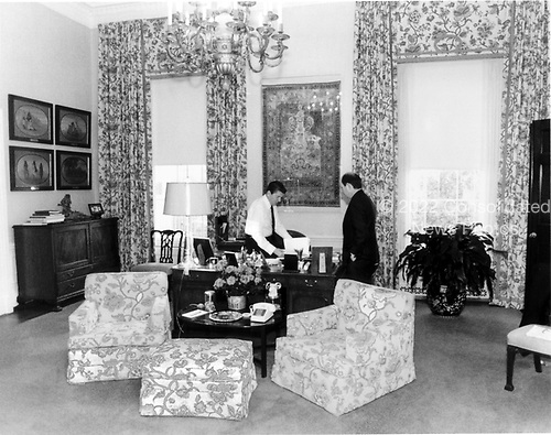 United States President Ronald Reagan confers with Michael Deaver, Assistant to the President, in the President's Study in the Residence at the White House in Washington, DC on November 18, 1981.