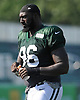 Muhammad Wilkerson #96 heads off the field after a day of New York Jets Training Camp at the Atlantic Health Jets Training Center in Florham Park, NJ on Wednesday, Aug. 9, 2017.