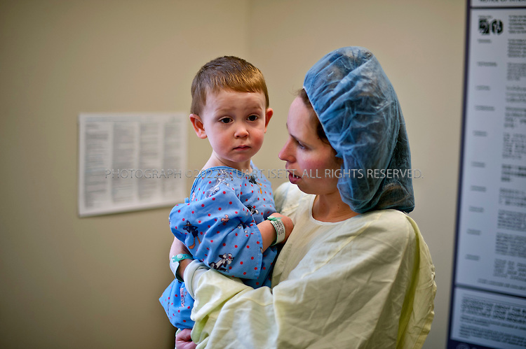 2/15/2012--Seattle, WA, USA..2 year old Devon Koester in the Dental Surgery Center at the Centerfor Pediatric Dentistry in Seattle, WASH., a joint center run by the Seattle Children's Hospital and the University of Washington to provide dental services to children and infants...Here Devon waits with his mother Melody Koetser (38) before being put under with a general anesthetic and having multiple cavities fixed...©2012 Stuart Isett. All rights reserved.
