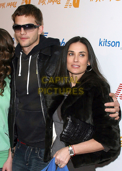 ASHTON KUTCHER & DEMI MOORE.Rebel Yell Spring Launch Party - Arrivals held at Kitson, .Beverly Hills, California, USA, .19 February 2006..half length celebrity couple married husband wife sunglasses black leather jacket fur coat.Ref: ADM/ZL.www.capitalpictures.com.sales@capitalpictures.com.©Zach Lipp/AdMedia/Capital Pictures