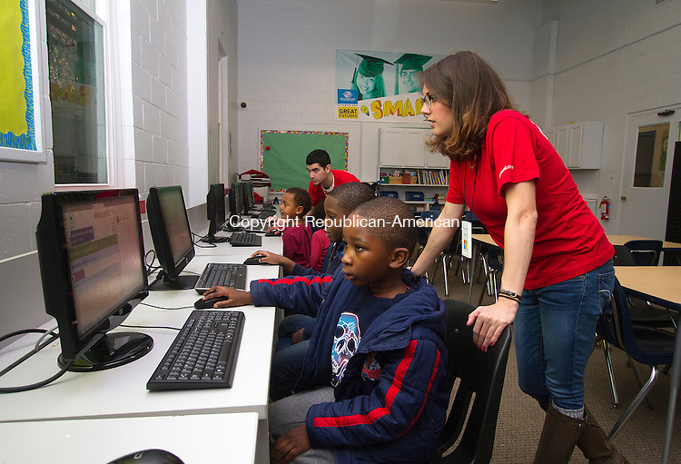 WATERBURY, CT - 14 NOVEMBER 2015 - 111415JW03.jpg -- Microsoft Community Development Specialist Carolyn Bighinatti helps Romaine Lee and Khayalethu Nkosi learn to code an application through Microsoft's Touch Develop online tutorial system Saturday morning at the Waterbury Boys & Girls Club of Greater Waterbury. Organizer Kevin Ombija and Waterbury Boys & Girls Club of Greater WaterburyExecutive Director Karen Senich say that they are looking toward making the program a regular occurance. For more information call Waterbury Boys & Girls Club of Greater Waterbury at 203-756-8104.    Jonathan Wilcox Republican-American