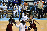 01 February 2015: North Carolina's Jamie Cherry (0) passes to Stephanie Mavunga (1) over Boston College's Kat Cooper (44) and Karima Gabriel (25). The University of North Carolina Tar Heels hosted the Boston College Eagles at Carmichael Arena in Chapel Hill, North Carolina in a 2014-15 NCAA Division I Women's Basketball game. UNC won the game 72-60.