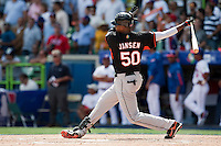 7 March 2009: #50 Kenley Jansen of the Netherlands swings and misses during the 2009 World Baseball Classic Pool D match at Hiram Bithorn Stadium in San Juan, Puerto Rico. Netherlands pulled off a huge upset in their World Baseball Classic opener with a 3-2 victory over Dominican Republic.