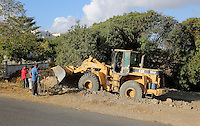 Pictured: Forensic archaeologists assisted by a digger, work at the second site in Kos, Greece. Thursday 13 October 2016<br />