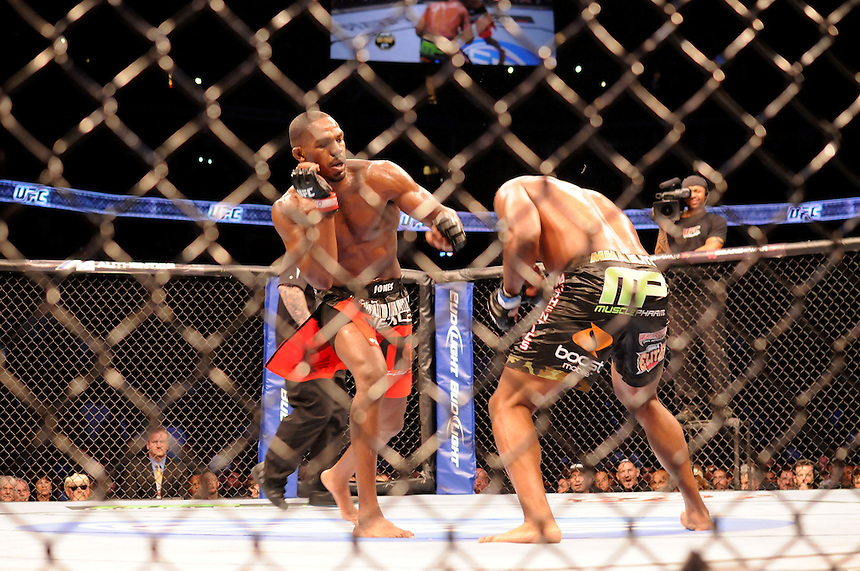 """24 SEPTEMBER 2011:   Jon """"Bones"""" Jones throws a punch at Quinton """"Rampage"""" Jackson   during UFC 135 at the Pepsi Center in Denver, Colorado. *****For Editorial Use Only*****"""