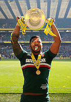 Manu Tuilagi lifts the Aviva Premiership trophy to the crowd. Aviva Premiership Final, between Leicester Tigers and Northampton Saints on May 25, 2013 at Twickenham Stadium in London, England. Photo by: Patrick Khachfe / Onside Images