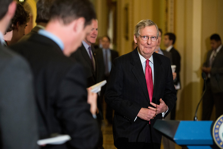 UNITED STATES - APRIL 1: Senate Minority Leader Mitch McConnell, R-Ky., arrives to speak with reporters following the Senate Republicans' policy lunch on Tuesday, April 1, 2014. (Photo By Bill Clark/CQ Roll Call)