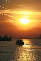 A Lake freighter sails towards Detroit on the Detroit River at Sunset, 07-0525, shipping, boat, river, city, ship. Detroit Michigan United States Detroit River.