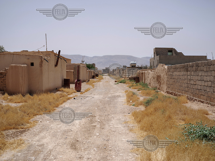 The street in Dogre village where Ali and his wife Shami, a Yazidi couple, lived before ISIS attacked in August 2014.