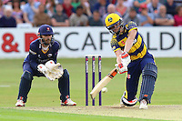 Aneurin Donald of Glamorgan hits out as James Foster looks on from behind the stumps during Essex Eagles vs Glamorgan, NatWest T20 Blast Cricket at the Essex County Ground on 29th July 2016