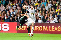 Thursday  03 October  2013  Pictured: Ben Davies takes the ball past Marco Mathys of St.Gallen<br /> Re:UEFA Europa League, Swansea City FC vs FC St.Gallen,  at the Liberty Staduim Swansea