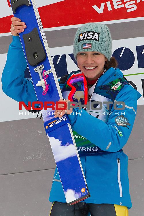 12.2.2012., Ljubno, Slovenia - Winner HENDRICKSON Sarah (USA) on the podium in Ladies FIS Ski Jumping World Cup 2012 on February 12, 2012 in Ljubno, Slovenia.<br /> <br /> Foto &copy; nph / Saso Domijan