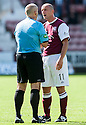 Arbroath's Paul Sheerin is spoken to by referee Stephen Finnie.
