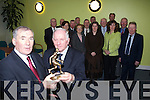 HONOURED: Former players of the 1957 Kerry Basketball team were honoured with trophies after fifty years on Monday. Front l to r were: Carmel O'Keeffe, Mary Lyne, Weeshie Fogarty, Paul Cantillon (Captain), Ann O'Connell, Marian O'Reilly and Paddy O'Reilly. Middle l-r were: Denis Foley, Denis Moriarty, Domonic Moriarty, Maurice Breen and Al O Donoghue. Back l to r were: John Dalton, Domo Lyne, John Walsh and Niall O'Keeffe.