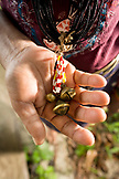 INDONESIA, Mentawai Islands, Kandui Resort, close-up of woman holding rosary