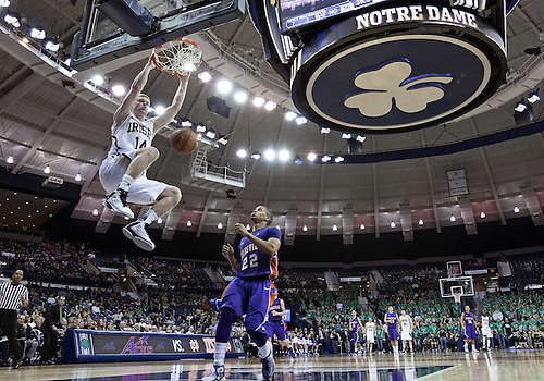 November 10, 2012:  Notre Dame guard Scott Martin (14) stuffs the ball as Evansville guard Ned Cox (22) defends during NCAA Basketball game action between the Notre Dame Fighting Irish and the Evansville Purple Aces at Purcell Pavilion at the Joyce Center in South Bend, Indiana.  Notre Dame defeated Evansville 58-49.