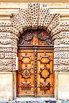 Carved wooden door, Aix-en-Provence. Provence, France